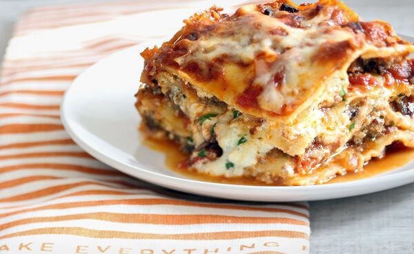 Lasagna sitting on a plate.
